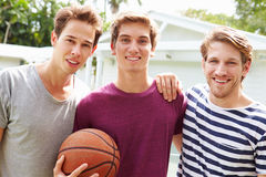 Portrait Of Young Men Playing Basketball Match Stock Images