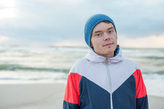 Portrait of young men in sportswear and hat near the sea Stock Photo