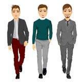 Portrait of young men walking forward Stock Photo
