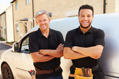 Portrait of a young and a middle aged tradesman by their van Stock Photography