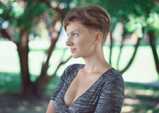 Portrait of young middle aged white caucasian girl woman with short hair stylish haircut  in tshirt looking away Stock Photography