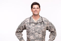 Portrait of a young military doctor posing against white backgro Stock Image