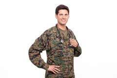 Portrait of a young military doctor posing with hand on hips Stock Photos