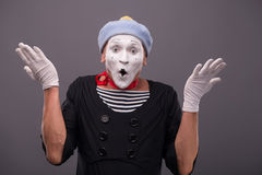 Portrait of young mime boy showing something with Royalty Free Stock Photography