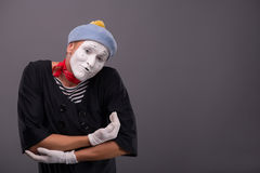 Portrait of young mime boy showing something with Royalty Free Stock Images