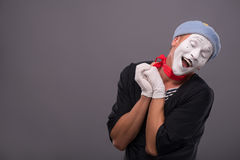 Portrait of young mime boy showing something with Royalty Free Stock Photos