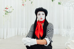 Portrait of young mime girl with black hat royalty free stock photography