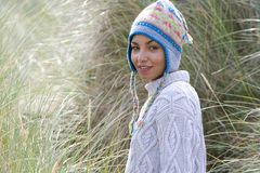 Portrait of young mixed race woman in hat outdoors Stock Photos