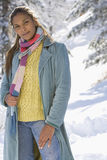Portrait of young mixed race woman standing in snow Stock Photos