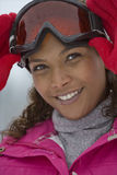 Portrait of young mixed race woman wearing ski goggles Royalty Free Stock Photos