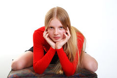 Portrait of young model. With long hair in red blouse Stock Image
