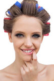Portrait of young model with hair curlers Royalty Free Stock Photo