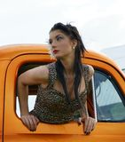 Pinup model in vintage truck stock image
