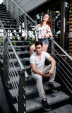 Portrait of young modern couple in love, posing outdoors in city street Royalty Free Stock Photos