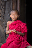 Portrait of a young monk in a monastery. Mandalay, Myanmar Stock Photos