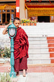 The portrait of young monk standing near the New Hall of Thikse Monastery Stock Photo