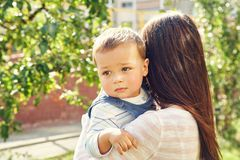 Portrait of a young mother with baby. Mom and son royalty free stock photography
