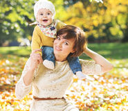 Portrait of young mother carrying baby Stock Photography