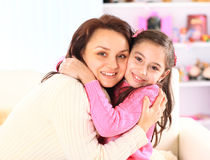Portrait of a young mother and daughter Royalty Free Stock Photo