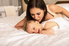 Portrait of young mother with her baby boy Royalty Free Stock Photos