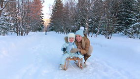 Portrait of a young mother with her child in winter stock video