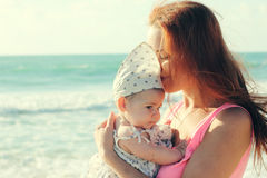 Portrait of young mother and her cute baby Royalty Free Stock Image