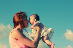 Portrait of young mother and her cute baby Royalty Free Stock Images