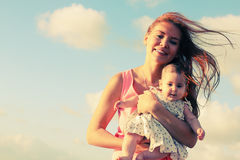 Portrait of young mother and her cute baby Royalty Free Stock Photos