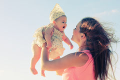 Portrait of young mother and her cute baby Royalty Free Stock Photo