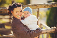 Portrait of Young mother and her cute girl having fun i on a countryside n autumn Royalty Free Stock Photos
