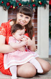 Portrait of young mother and her daughter Royalty Free Stock Photos