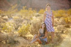 Portrait of a young mother and her daughter in desert of Red Roc Royalty Free Stock Photography