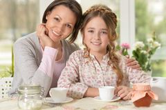Mother and daughter drinking tea Stock Image