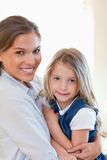 Portrait of a young mother and her daughter posing Stock Images