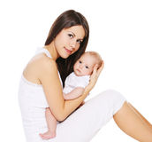 Portrait of young mother with her infant on hands Stock Photo