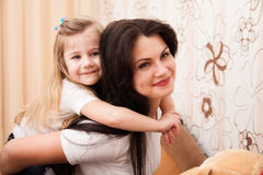 Portrait of young mother and her small daughter. Stock Images