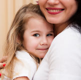 Portrait of young mother and her small daughter. Royalty Free Stock Photography