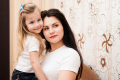 Portrait of young mother and her small daughter. Stock Photo