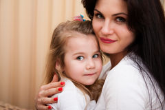 Portrait of young mother and her small daughter. Royalty Free Stock Photos