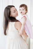 Portrait of a young mother and little daughter royalty free stock image