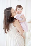 Portrait of a young mother and little daughter royalty free stock photo
