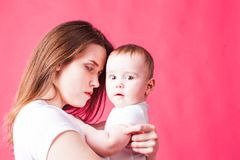Portrait of young mother looking at her baby royalty free stock image