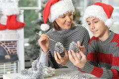 Mother with son preparing for Christmas. Portrait of young mother with son preparing for Christmas Stock Photos