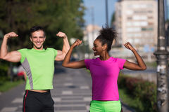 Portrait of young multietnic jogging couple ready to run Royalty Free Stock Image