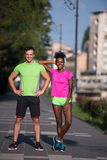 Portrait of young multietnic jogging couple ready to run Stock Images