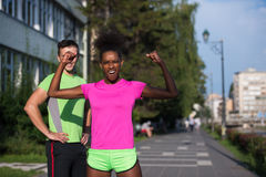Portrait of young multietnic jogging couple ready to run Stock Photography