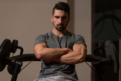 Portrait Of A Young Muscular Athletic Man Posing While Sitting A Royalty Free Stock Image
