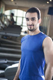Portrait of young muscular man in the gym Royalty Free Stock Photo