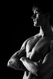 Portrait of a young muscular naked man. Studio portrait of a young muscular naked man Royalty Free Stock Photos