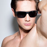 Portrait of young muscular sexy man in glasses. Stock Photo